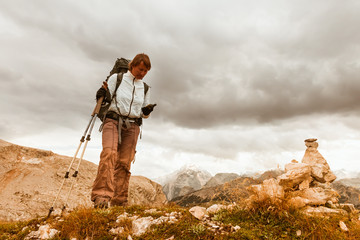 hiker young woman with GPS navigator