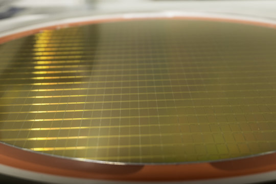 close up view of silicon wafers examination before production in a clean room, .detail of a silicon wafer reflecting colors, Semiconductor hi tech industry