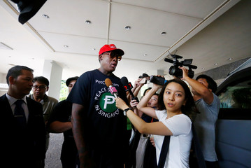 Former U.S. basketball star Dennis Rodman makes an appearance at Regent Hotel in Singapore