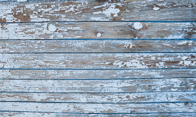 Old painted texture vintage wood background with peeling paint. Painted weathered plain teal blue and white Rustic Wood Board Back ground that can be either horizontal or vertical.