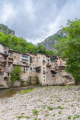 Pont-en-Royans in the Vercors, typical colorful houses built on the cliff, over the river, in France