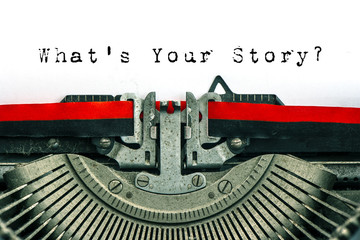 Antique typewriter text What's Your Story white paper background
