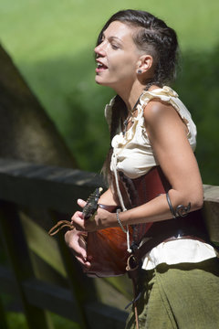 pretty celtic bard singing in the forest