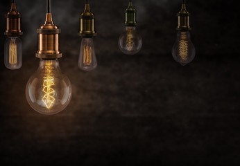 Vintage light bulbs on dark background.