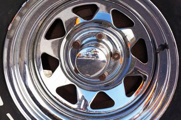Chromed metal rim. Car alloy wheel.