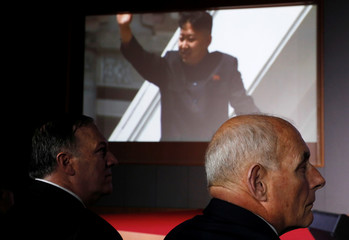 U.S. Secretary of State Mike Pompeo and White House Chief of Staff John Kelly listen as U.S. President Donald Trump speaks during a news conference after his meeting with North Korean leader Kim Jong Un at the Capella Hotel on Sentosa island in Singapore