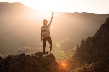 Beautiful woman on the top of mountain