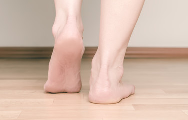 Heel and foot girl. The concept of flat feet.