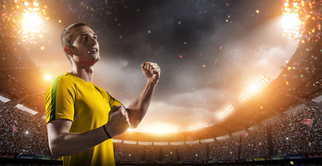 Happy soccer player with goal joy in the 3d imaginary stadium background.