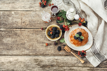 BlackBerry pancakes with fresh berries. Food background with copy space. Top view