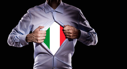 Business man with italian flag on black background