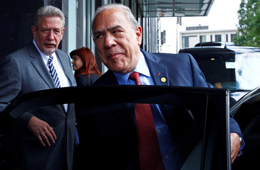 OECD Secretary-General Angel Gurria leaves after a news conference to present the economic report on Germany in Berlin