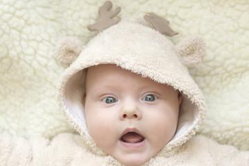 Portrait of a cute kid in a deer suit