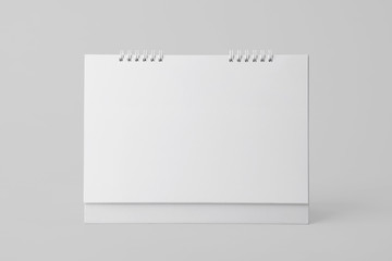 Blank paper spiral calendar for mockup template advertising and branding background.