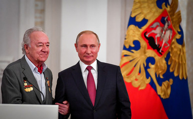 Russian President Putin and conductor Temirkanov attend an awarding ceremony marking the Day of Russia in Moscow