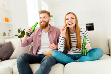 Weekend holiday vacation joy enjoy leisure fun date concept. Excited cheerful joyful delightful attractive rejoicing students eating junk food drinking alcohol beer sitting on divan watching sport