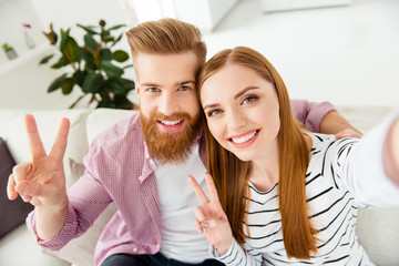 Coziness make indoors friendship cuddle pleasure honeymoon husband wife caucasian  feelings emotions concept. Close up portrait of cute sweet excited couple in casual clothes taking picture new flat