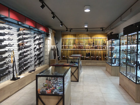 KHARKOV, UKRAINE, June 6, 2018: Showcases in the arms store with rifles, cartridges and pistols