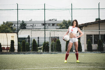 Young female football player at football field ready for football match