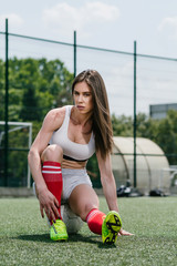 Young female football player at football field