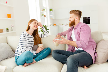 Fun coziness communication two partners morning feelings emotions coziness concept. Excited cheerful lovely sincere cute attractive young people enjoying tea cacao hot beverage and gossiping