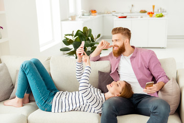 People partners communication message entertainment relax rest chill concept. Pretty cute lovely charming girl demonstrating funny news she found on the internet holding mobile in hands