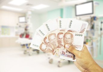 Foto auf Acrylglas Hund Healthcare costs concept.Hand of human hond money for medical costs in modern hospital.