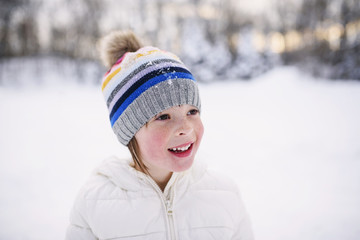 Portrait of a girl standing in the snow