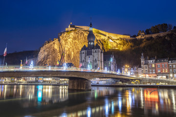 Dinant cityscape, Belgium. Collegiate Church of Our Lady near Meuse river.