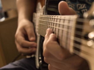hand with guitar close-up5