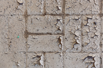 Old brick wall with cracked paint