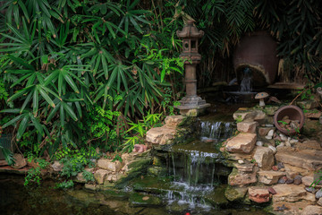 Small waterfall with decorative pond