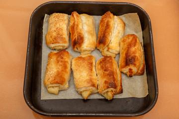 Seven bourekas on square pan