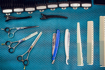 Close up cropped photo accessories barber shop stylist. He is organizing them in order his work place