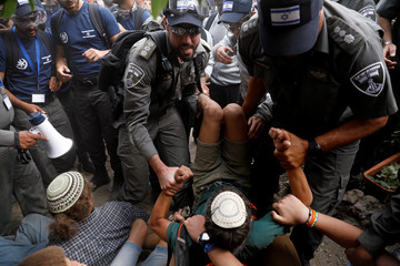Israeli security forces scuffle with protesters during the eviction of Jewish settler families from the illegal outpost of Netiv Ha'avot in the occupied West Bank