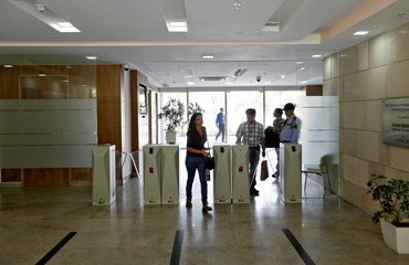 Employees arrive for work at Tech Mahindra office building in Noida