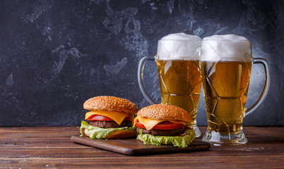 Photo of two hamburgers, glasses with beer