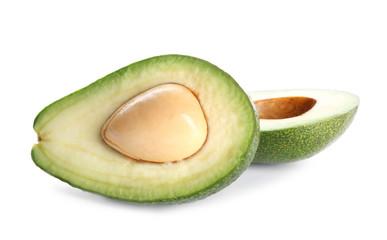 Halves of ripe avocado on white background