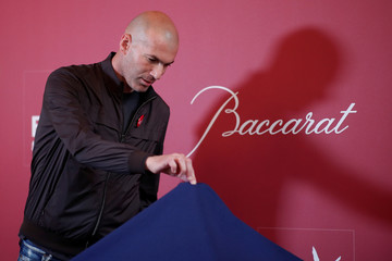 "Former French soccer player and European Leukodystrophy Association (ELA) patron Zinedine Zidane looks at the ""Zidane's Crystal Foot"" created by Baccarat before its unveiling in Paris"