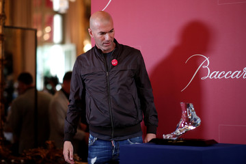 "Former French soccer player and European Leukodystrophy Association (ELA) patron Zinedine Zidane poses with the ""Zidane's Crystal Foot"" created by Baccarat in Paris"