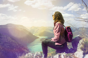 Girl relaxing on a beautiful mountain view.