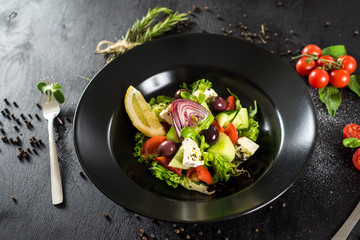 Fresh tasty salad dish with vegetables and herbs