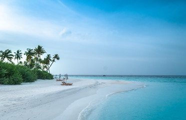 Maldives beautiful beach background white sandy tropical paradise island with blue sky sea water ocean