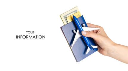 Miniature airplane international passport money dollars payment card in hand travel pattern on white background isolation