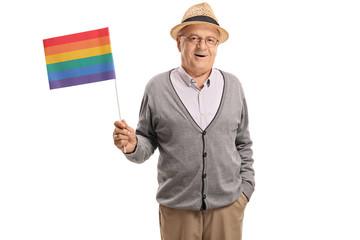 Mature man holding a rainbow flag