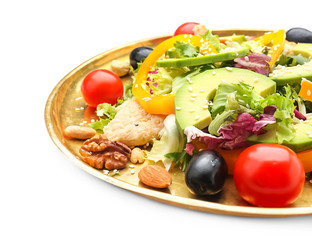 Plate of tasty salad with ripe avocado on white background, closeup