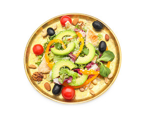 Plate of tasty salad with ripe avocado on white background