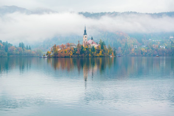 Amazing view of Lake Bled at foggy autumn morning
