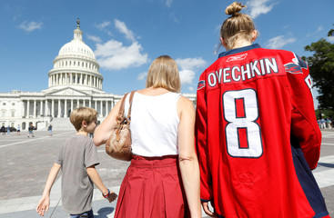 Washington Capitals fans make their way past the U.S. Capitol prior to a victory parade for the Stanley Cup champions in Washington