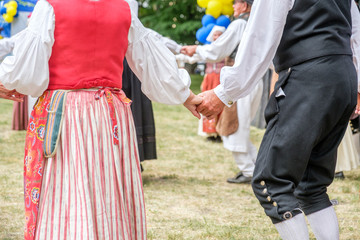 Unrecognizable people perform Swedish folk dance during National day celebration in Norrkoping